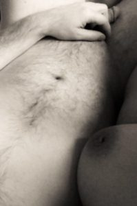 Exposing 40's breast up against naked mans chest
