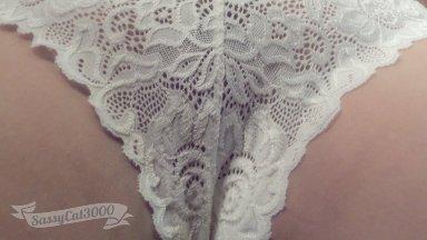 Close up shot of lace panties between her legs