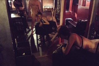 woman laying on spanking bench, nude man spaking her, female dom taking the picture reflected in mirror