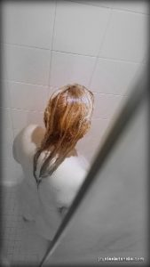 looking down on Woman in shower with red golden hair