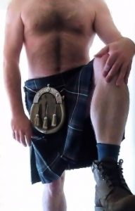 Topless man in kilt