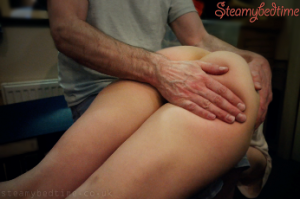 Woman getting an over the knee spanking
