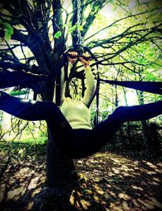 woman in sex swing in woodlands