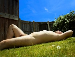 Man laying naked in the sun