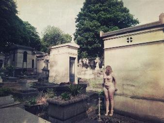 Woman naked in gothic graveyward in paris