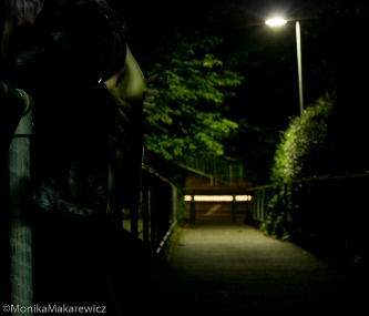 Woman waiting topless on a bridge in the night