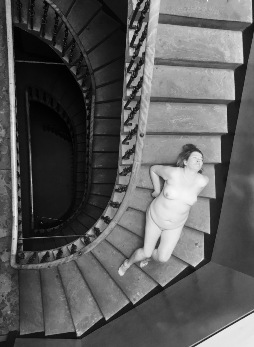 Woman laying on the stairs of spiral staircase