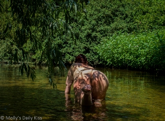 Molly crawling in stream with shadows from weeping willow on her back and bottom