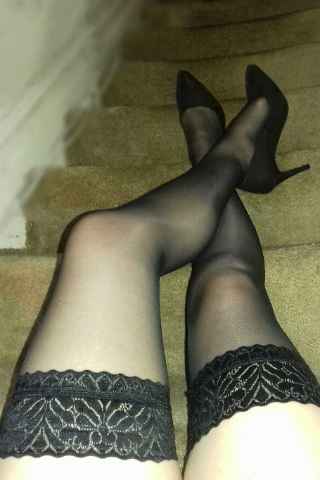 woman in lace stocking on stairs