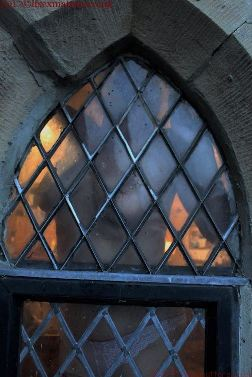 Naked woman pressed up against tudor window