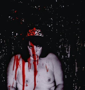 Nude Woman wearing crown with fake blood splattered over her