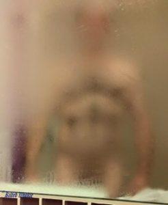 Hairy man in shower