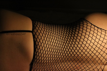 womans back in fishnet body stocking