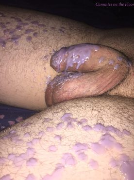 mans penis and thighs covered in purple wax