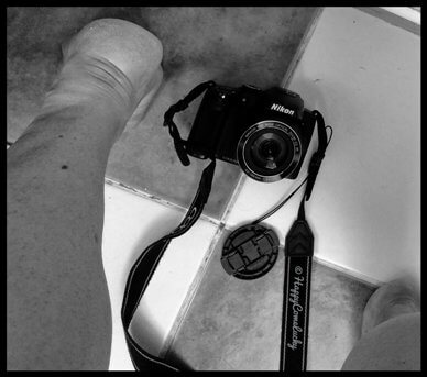 Woman's feet standing over camera which is on the floor pointing up between her legs