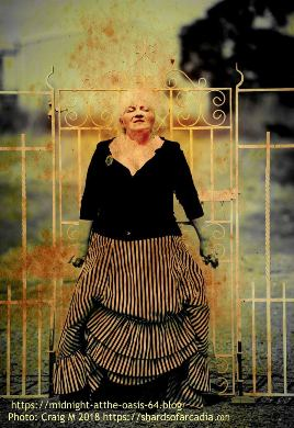 woman in vistorian dress in front of iron gates with vinatge edit