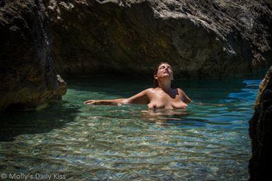Woman topless in the sea