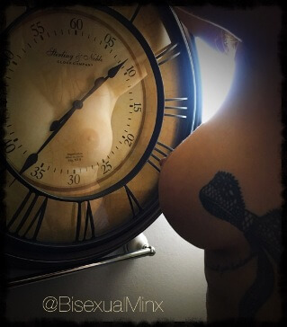 woman topless in front of large old fashioned clock