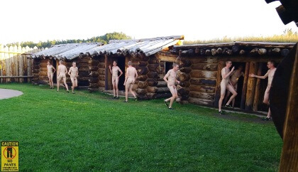 multiple exposure of naked man running between cabins