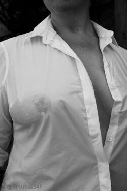Topless woman wearing white wet see through shirt