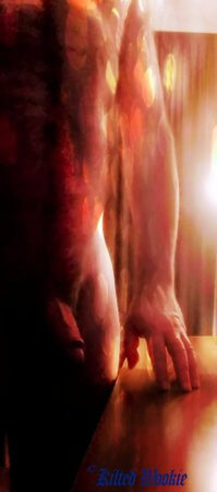 Male nude with bokeh effect highlighting his cock and hand