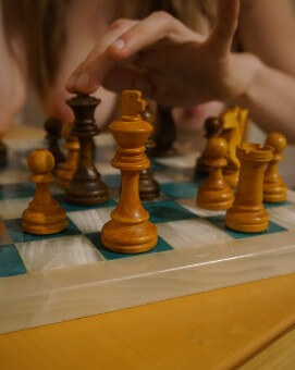 Topless woman playing chess