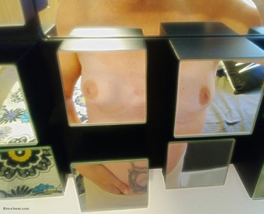 topless woman in block squared mirrors