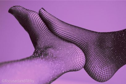 womans feet in sparkly fishnets in purple light