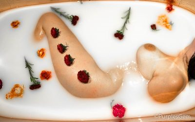 Woman laying on her side in milk bath