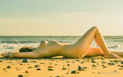 Nude woman laying on the beach