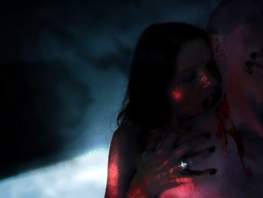 Vampire woman biting the neck of a man