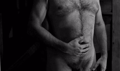 black and white of nude man with hairy chest