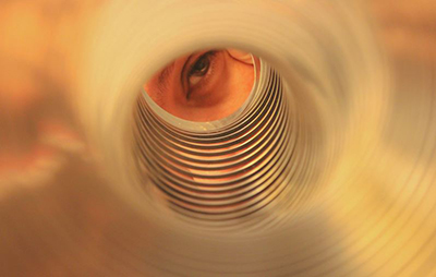 looking through a slinky to an eye in the distance