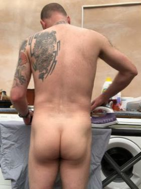 Man doing ironing in the nude