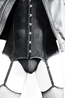 Person in corset and fishnet stockings