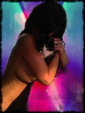 naked woman hugging a cat
