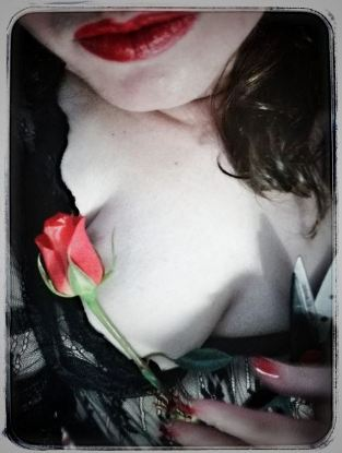 kate lessons being morticia holding a red rose to her breast