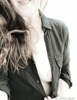 woman open black shirt to reveal her breasts