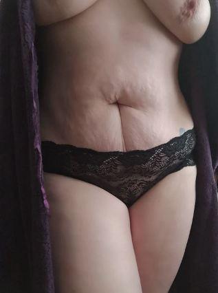 woman weaing black panties with bathrobe open
