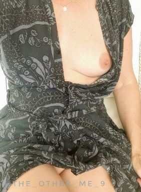 Woman with dress open showing her breasts