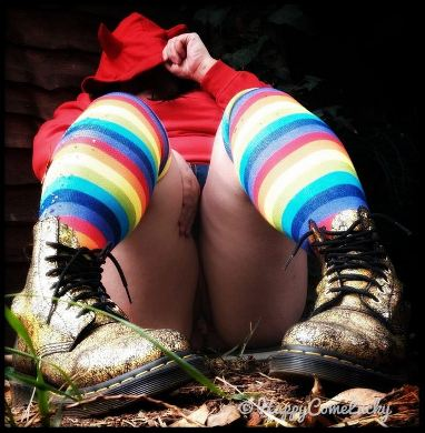 Woman wearing striped socks and gold boots
