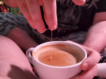 Fingeers dripping cum into a cup of coffee