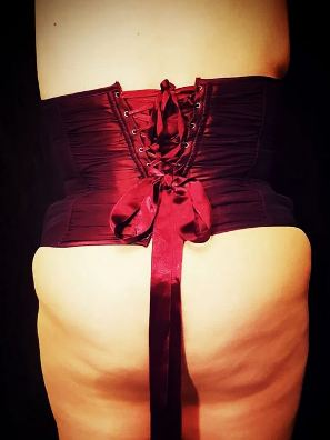 back view of woman wearing deep red corset