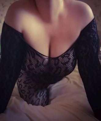 woman in lace bodystocking