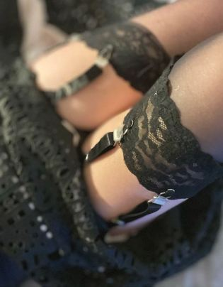legs in lace top stockings and suspenders