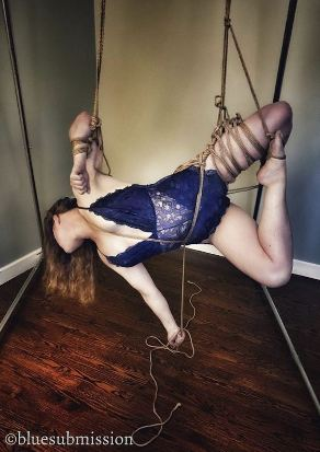 woman in blue lingerie suspended in rope