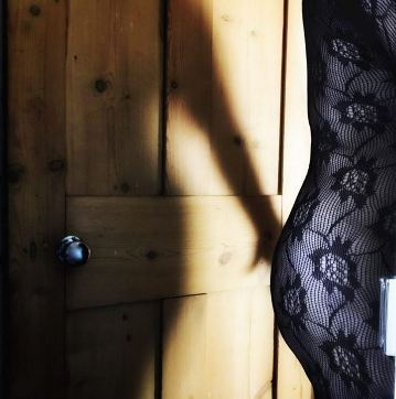 shadow on person in body stocking leaving the room