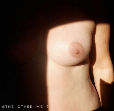 dark shadow over breast with one breast in bright sunlight