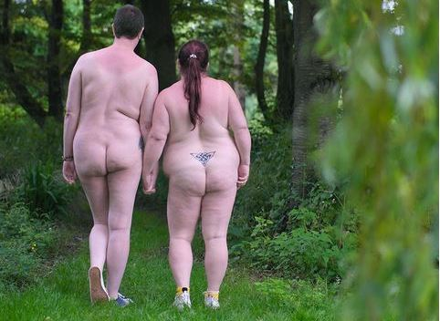 Bee and honey naked holding hands in the woods